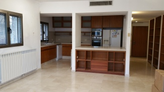Kitchen w/ counter to Living Area