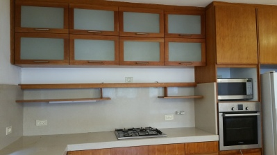 Cabinets above and below gas cooktop